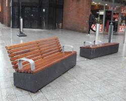 Dark grey polished benches.
