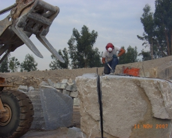 Splitting stone.