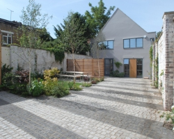 A Hampstead mews development with grey and dark grey demarcations