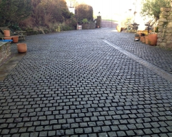 A large driveway with 10 10 10 grey setts
